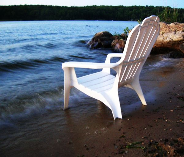 chair in Coventry lake Chair In Water Coventry Ct Lakeshore Tranquil Scene