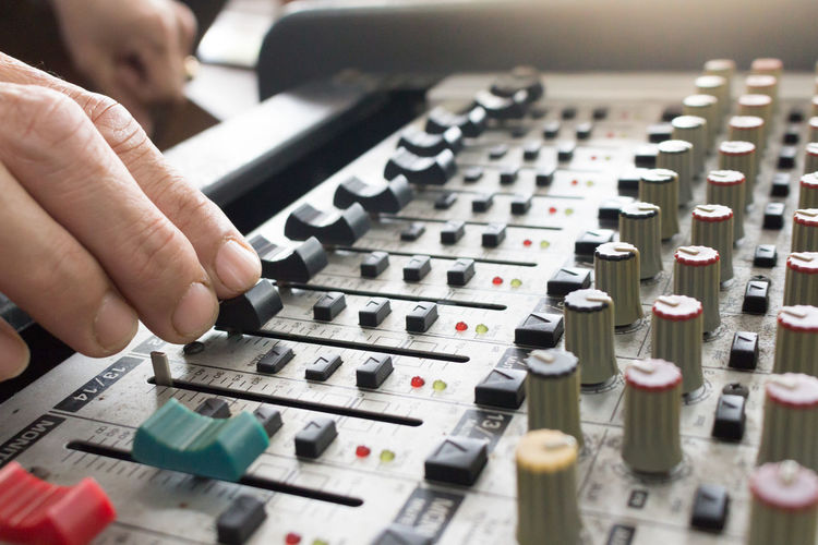 Music Human Hand Control Sound Mixer Audio Equipment Hand Sound Recording Equipment Technology One Person Arts Culture And Entertainment Adjusting Recording Studio Human Body Part Studio Selective Focus Close-up Indoors  Control Panel Mixing Push Button Finger