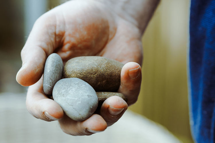 MY STONE COLLECTION Close-up Day Focus On Foreground Holding Human Body Part Human Hand Indoors  Midsection One Person Pebble Pebbles Pebbles And Stones People Real People Stone Stones Stones And Pebbles