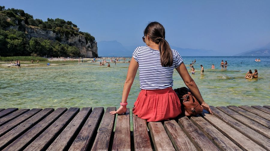 Striped Only Women Adult Adults Only One Woman Only Sea People Travel Young Adult Vacations Young Women Water Beach Travel Destinations Women One Young Woman Only Sand One Person Sky Human Body Part Italy Sirmione