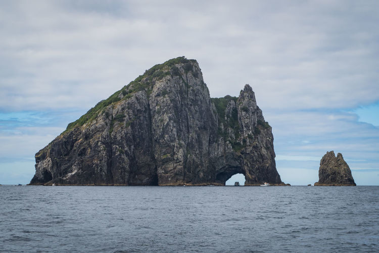 hole in the rock at the bay of islands in new zelands bay of islands Travel Beauty In Nature Cloud - Sky Day Formation Horizon Over Water Idyllic Nature New Zealand No People Non-urban Scene Outdoors Pacific Ocean Rock Rock - Object Rock Formation Scenics - Nature Sea Sky Solid Stack Rock Tranquil Scene Tranquility Water Waterfront The Great Outdoors - 2018 EyeEm Awards