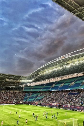 Soccertime Rb Leipzig Cloudcollection Dramatic Sky Eye4photography  Eyem Gallery Clouds And Sky Sommer 2018 Group Of People Crowd Sport Sky Large Group Of People Nature Cloud - Sky Stadium Real People Grass Men Green Color Team Sport Soccer Field Competition Adult Soccer Playing Outdoors Spectator