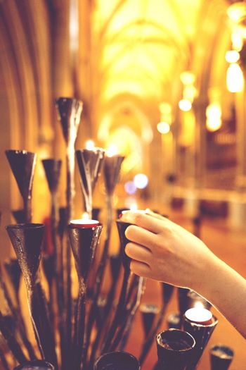 Candle Light Cathedral Church Lit Candlelight Illuminated Indoors  Close-up Hand Human Hand One Person Drink