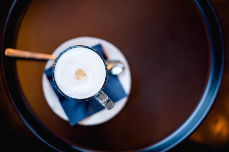Directly Above View Of Fresh Cappuccino Served On Table At Cafe
