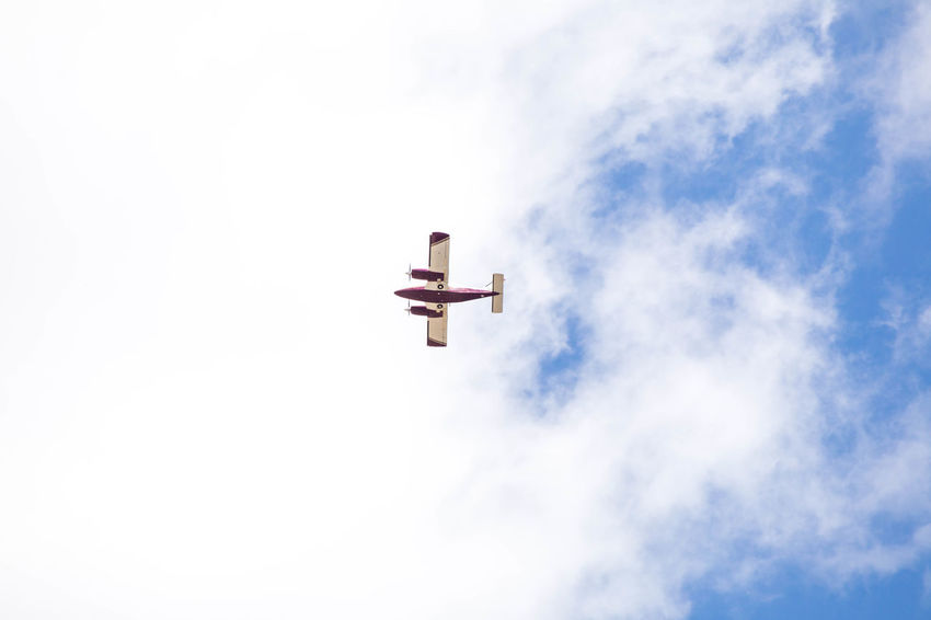 Dual propeller plane flying in cloudy summer sky. Planes In The Sky Air Vehicle Airplane Belief Classic Planes Cloud - Sky Copy Space Cross Day Directly Below Flying Low Angle View Mid-air Mode Of Transportation Nature No People on the move Outdoors Plane Planes Sky Transportation