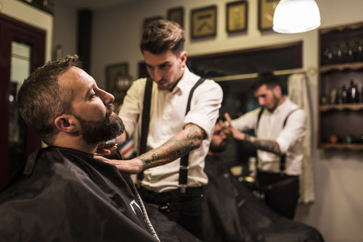 Man Shaving Customers Beard