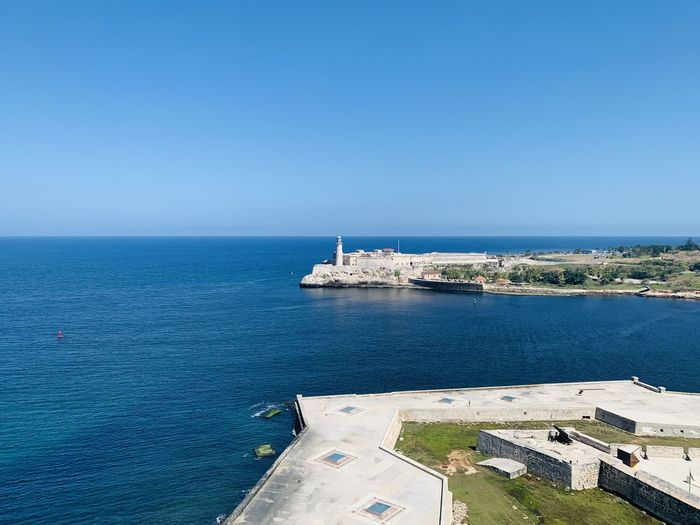 Scenic view of sea against blue sky. port entrance at havana.