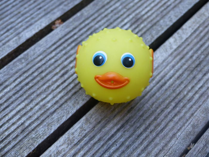 Close-up of rubber duck on table