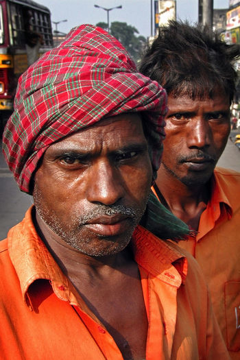 Street coolie helpers in Calcutta, India Calcutta Adult Casual Clothing Close-up Front View Headshot Indoors  Lifestyles Looking At Camera Males  Mature Adult Mature Men Men Mid Adult Mid Adult Men Outdoors People Portrait Real People Two People Young Men