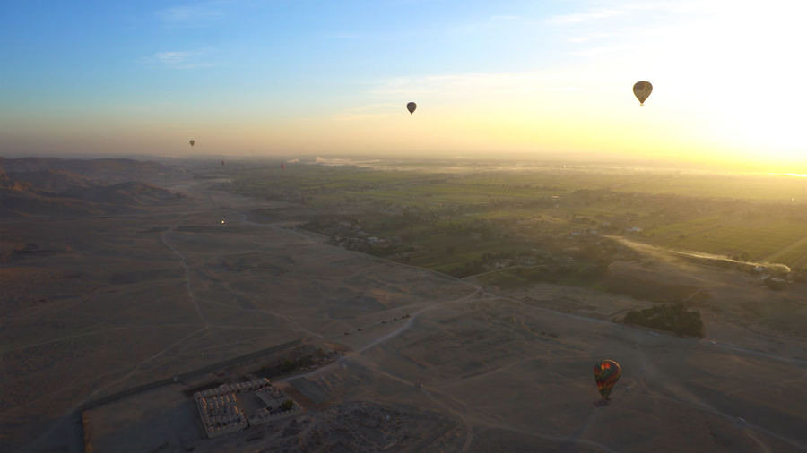 Aerial view of hot air balloon at sunset