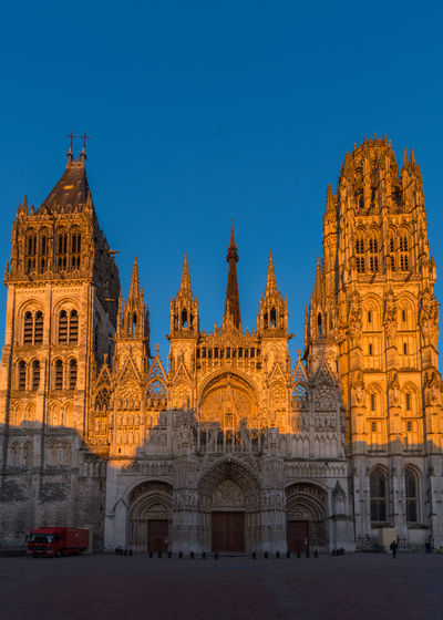 Rouen, France-May 22, 2019: Beautiful Rouen cathedral on blue sky background. Architecture Summer Old City Beautiful France Art Church Sky Worship Background Cathedral Façade Gothic Tourist Building Travel Tourism Sunlight Square Day Town History Ancient Tower Religion Famous Style Exterior Landmark Europe Christian Catholic Medieval Attraction Destination Monument Outdoor Historic French Notre-Dame Normandy Religious  European  Rouen Historical Notre Dame Travel Destinations Building Exterior
