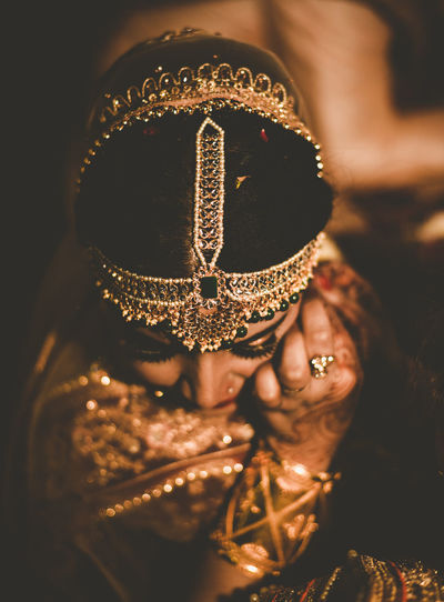 she is a JEWEL👑 Wedding Indian Wedding Bride Closeup Candid Candid Photography Portrait Gold Colored Headshot Illuminated Mask - Disguise Close-up Glitter Carnival - Celebration Event Costume Glittering Religious Event Costume Wing