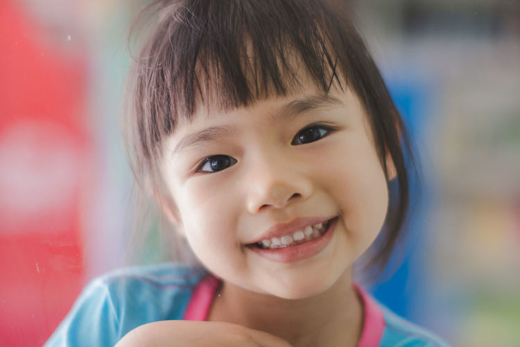 Bangs Child Childhood Close-up Cute Emotion Females Focus On Foreground Front View Gap Toothed Girls Hairstyle Happiness Headshot Human Face Innocence Lifestyles Looking At Camera One Person Portrait Real People Smiling