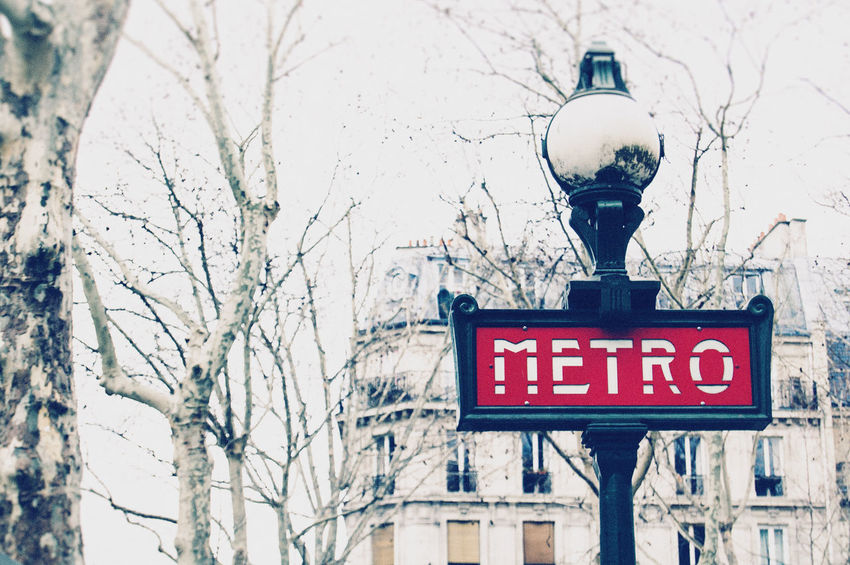 Paris Metro Vintage Sign Architecture Day Destination Europe French Information Information Sign Low Angle View Metro Metro Sign No People Outdoors Paris Paris Metro Road Sign Sky Travel Photography Tree Tree Branches Windows
