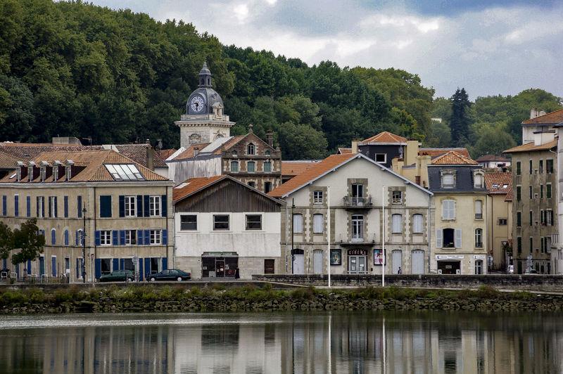 Buildings by river nive at saint-jean-pied-de-port