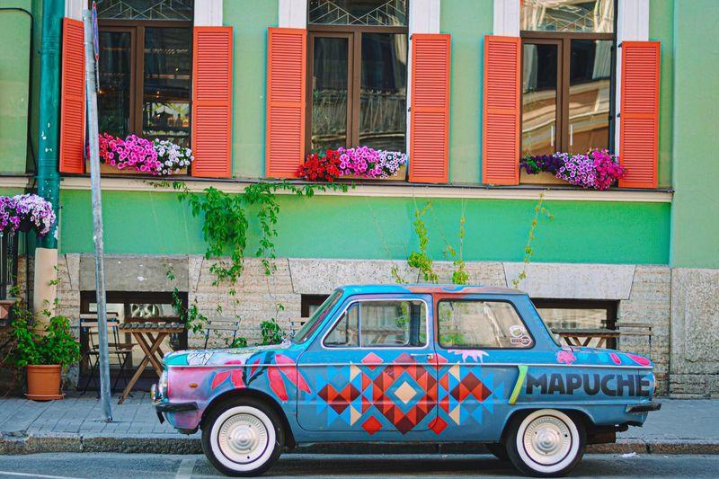Vintage car on street by building