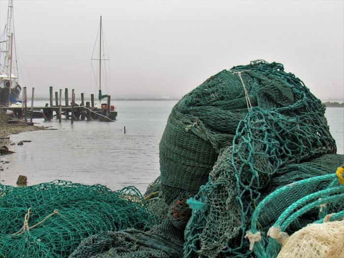 Shrimp Nets Commercial Fishing Net Day Fisherman Fishing Equipment Fishing Net Fishing Tackle Military Mode Of Transport Nature Nautical Vessel Outdoors People Real People Sea Sky Water Premium Collection