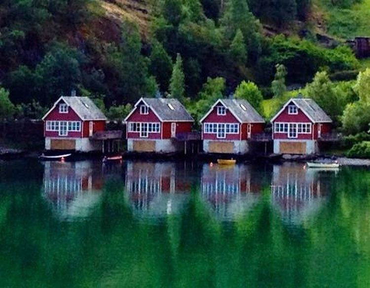 4 houses. Water Hut Reflection Outdoors Nature Built Structure Lake Stilt House Architecture Tranquility Building Exterior No People Tree Day 100 Forest Scenics