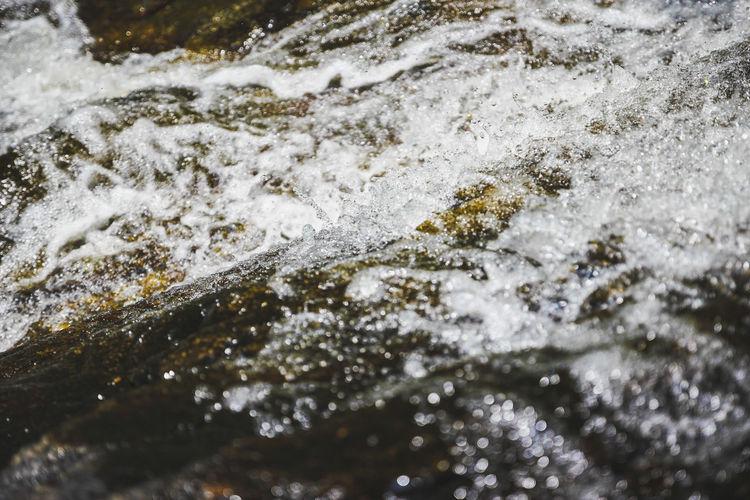 Close-up of water splashing on rocks