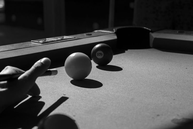 Cropped image of man playing snooker