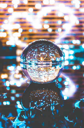 Appreciate the beauty in everything Illuminated Decoration Sphere Close-up No People Focus On Foreground Shiny Lighting Equipment Reflection Christmas Glass - Material Indoors  Christmas Decoration Single Object Night Holiday Crystal Ball Transparent Selective Focus Crystal Christmas Ornament Electricity  Light Lens Ball Bokeh