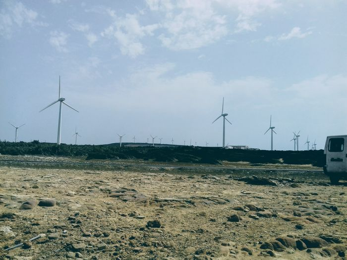 Wind Turbine Windmill Wind Power Technology Alternative Energy Electricity  Fuel And Power Generation Turbine Rural Scene Beach