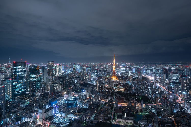 Architecture Building Exterior Built Structure City Cityscape Illuminated Sky Building Night Cloud - Sky Crowd Crowded Travel Destinations Tall - High Tower Modern Nature Skyscraper Office Building Exterior Outdoors Spire  Financial District  Tokyo Japan