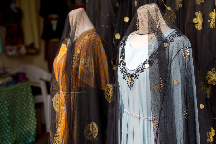 Different abaya style dresses displayed in the shop in dubai souq