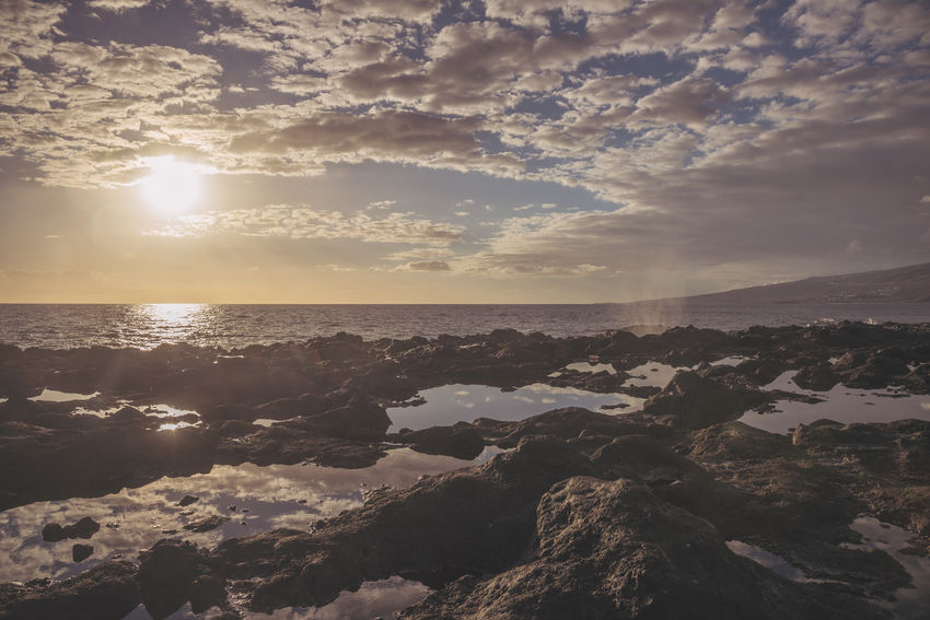 Tidal pool in la Reunion island (pointe au sel, Saint Leu) Beach Beauty In Nature Cloud - Sky Day Horizon Over Water Nature No People Outdoors Reflection Reunion  Reunion Island Scenics Sea Sky Sun Sunlight Sunset Tidal Pool Tranquil Scene Tranquility Travel Vintage Water
