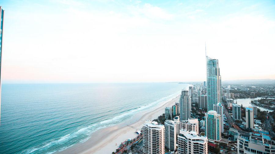 Ariel view of the sunset on the Gold Coast, Australia . Architecture Beach Building Exterior Built Structure City Cityscape Day Development Downtown District Futuristic Growth High Angle View Modern Nature No People Outdoors Scenics Sea Sky Skyscraper Tower Travel Destinations Urban Skyline Water Wide Shot