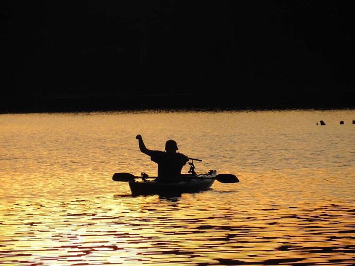 Sunsets and silhouettes Silhouette Water One Person Transportation Sunset Sitting Real People Oar Kayak Leisure Activity Nature Nautical Vessel Outdoors Men Night Rowing Lifestyles Sea Adult People 100 Days Of Summer