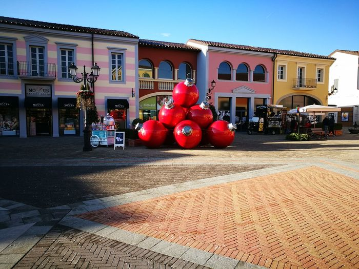 SerravalleScriviaoutlet Red Street Land Vehicle City Street Built Structure City Architecture Outdoors Building Exterior No People Sky Day Colurs And Shapes