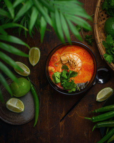 High angle view of thai tom yum soup in bowl on table