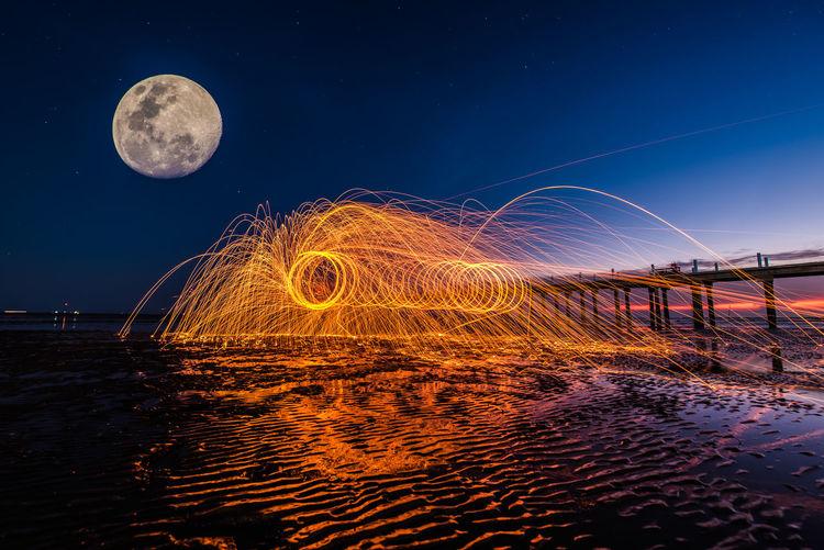 full moon on the fire Fire Astronomy Moon Water Sky Moon Surface Full Moon Star Field Moonlight Half Moon