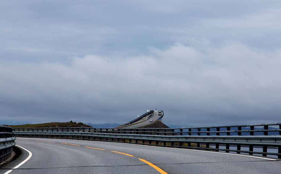 Landscape of Norway, Atlantic Ocean Road. Atlantic Road Eide Norway Travel Architecture Atlantic Ocean Road Bridge - Man Made Structure Built Structure Cloud - Sky Connection Day Direction Dividing Line Highway Land Vehicle Marking Mode Of Transportation Motor Racing Track Nature No People Norway Nature Outdoors Road Road Marking Sign Sky Symbol The Way Forward Transportation