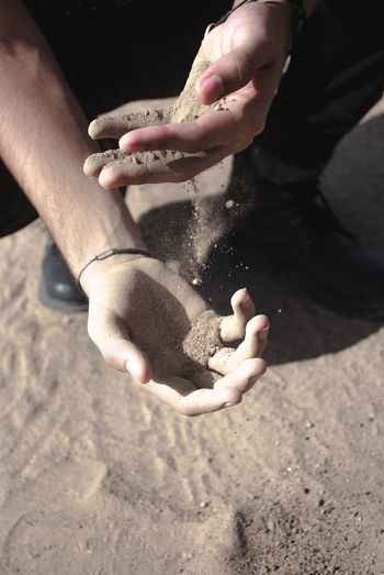 High angle view of man playing with sand