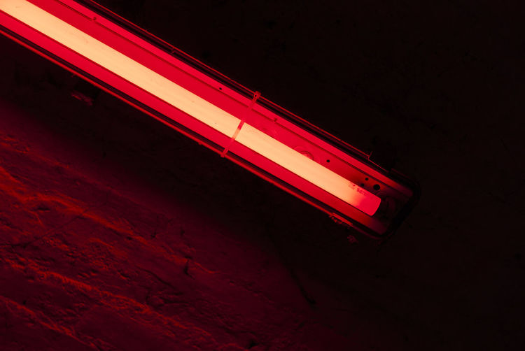 Illuminated fluorescent light by wall