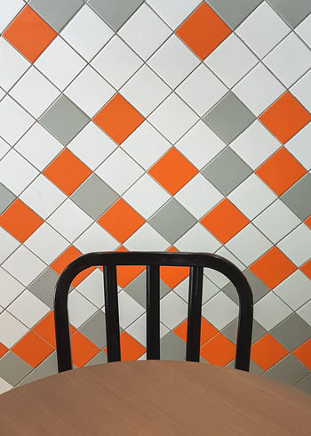Architecture Built Structure Design Empty Chair Emt Geometric Shape Indoors  Multi Colored Pattern Repetition Tile Wall Wall - Building Feature