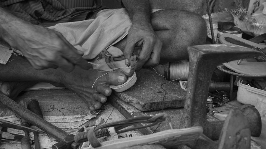 Low Section Of Cobbler Sewing Sandal At Workshop