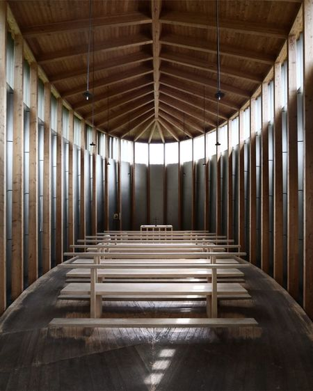 Wooden Benches Below Roof Beam In Church