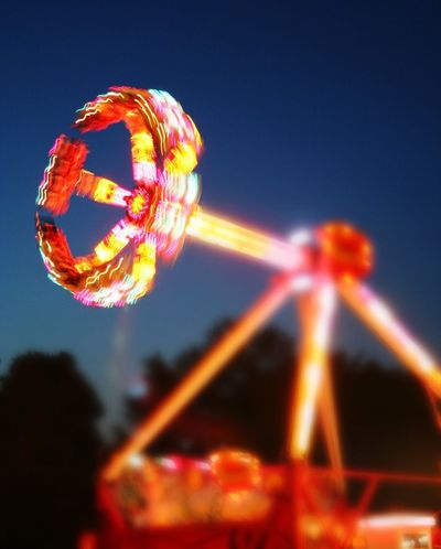 Fire Ball ride with intentional blur at county fair in Berrien County, Michigan Arts Culture And Entertainment Night Amusement Park Ride Amusement Park Illuminated Outdoors Motion No People Intentional Blur Light Trails Fair Carnival Rides Carnival Family Fun Fire Ball