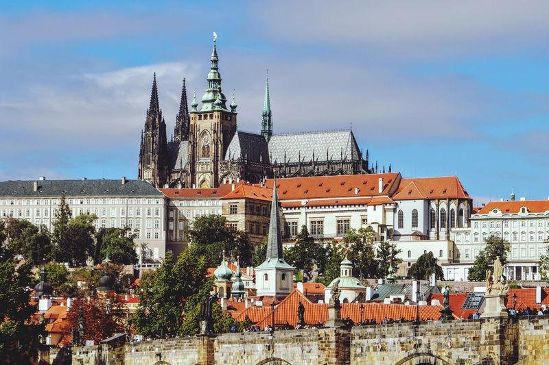 View of temple against buildings in city prague