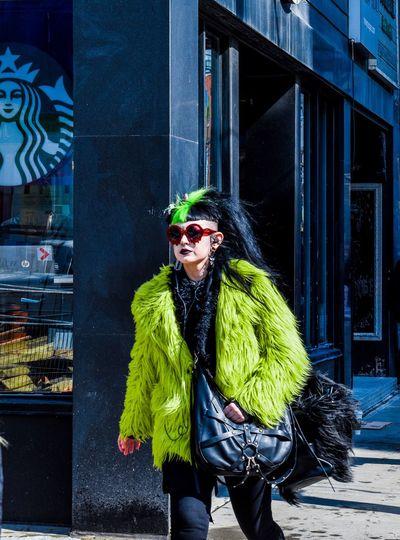 Portrait of mature woman wearing sunglasses outdoors