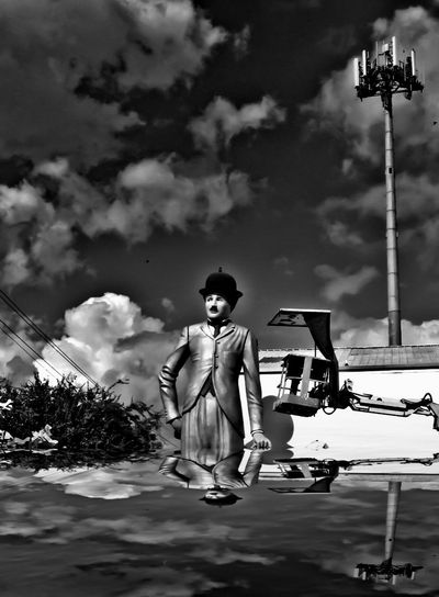 Outdoors Cloud - Sky Real People Water Adult People One Person Day One Man Only CharlieChaplain Charlie Chaplin Charliechaplin Statue In The City Atmosphere Black And White Photography Blackandwhite , Likee My Pic : ) Reflection Reflections In The Water