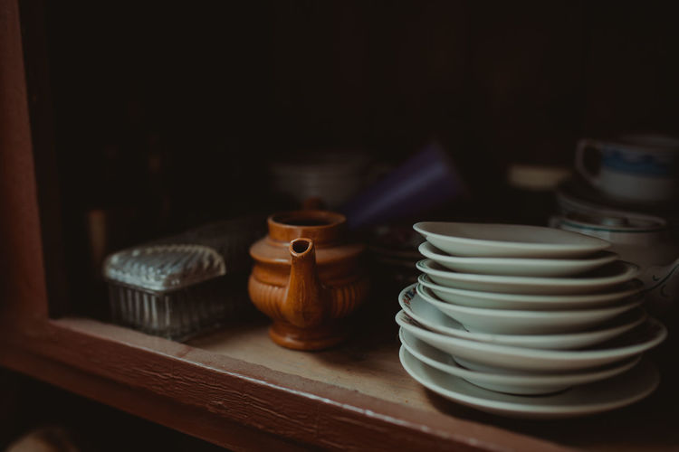 Close-up of kitchen utensils on shelf