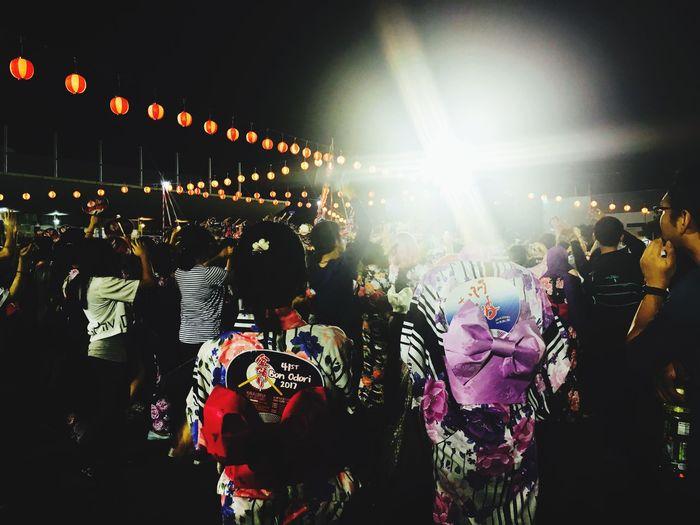 Group of people at illuminated street light at night