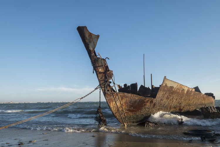 Rusty ship wreck at the beach of Nouadhibou Ship Wreck Morning Seaside Beach Shoreline Nautical Vessel Water Transportation Sea Mode Of Transportation Sky Shipwreck Ship Abandoned Nature Deterioration Damaged Decline Day Obsolete Run-down Clear Sky Land No People Outdoors Ruined Sailboat Sinking