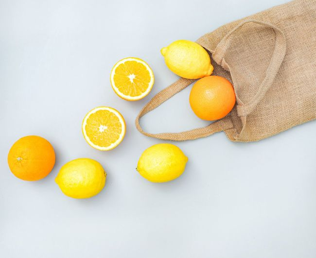 High angle view of orange fruits on white background