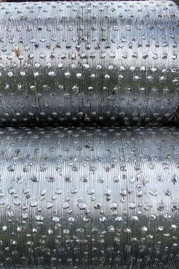 Full frame shot of wet metal grate