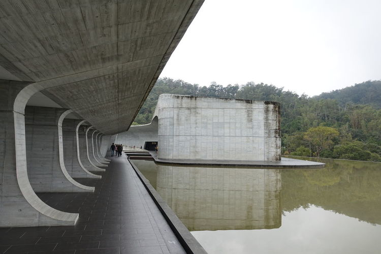 Architecture Perspective Reflection Taiwan Visitor Center Built Structure Concrete Day No People Outdoors Reflections In The Water Sun Moon Lake Water